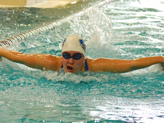 Lakeland's Jillian Schupbach swims the 100-yard butterfly