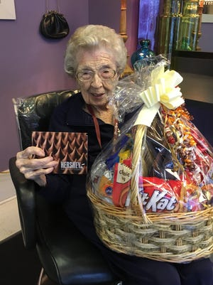 Centenarian Frances Oldham, who loves to eat Hershey's chocolates at breakfast and throughout the day, received a large gift basket from the Hershey company in honor of her 100th birthday.