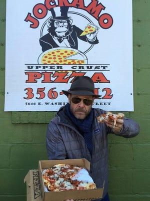 Food Network host Alton Brown digs in at Jockamo Pizza in Irvington.