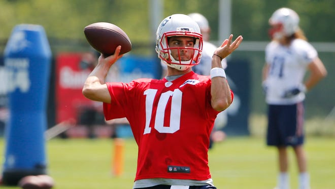 New England Patriots quarterback Jimmy Garoppolo (10) throws during OTA's at Gillette Stadium.