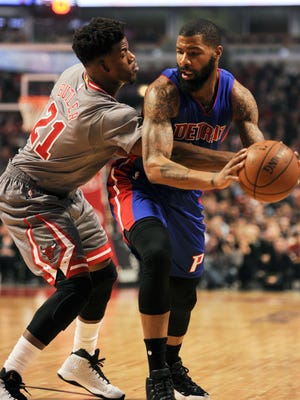 Pistons forward Marcus Morris (13), right, passes against Bulls guard Jimmy Butler (21) in the 1st quarter Saturday in Chicago.