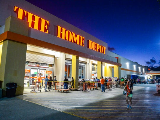 Shoppers wait in line for the 6:00 a.m. opening of the doors at The Home Depot for the store's Black Friday sale on Nov. 27.