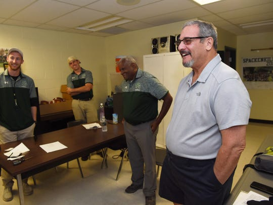 Dave Gettleman, right, former general manager of the Carolina Panthers and a founder of Spackenkill High School's football program, speaks with the assistant coaches in their office at Spackenkill High School in October.