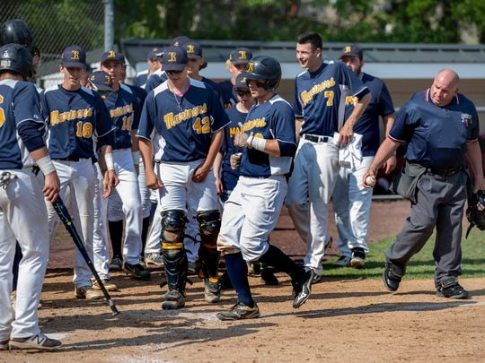 Toms River North's Jonathan Giordano is greeted by