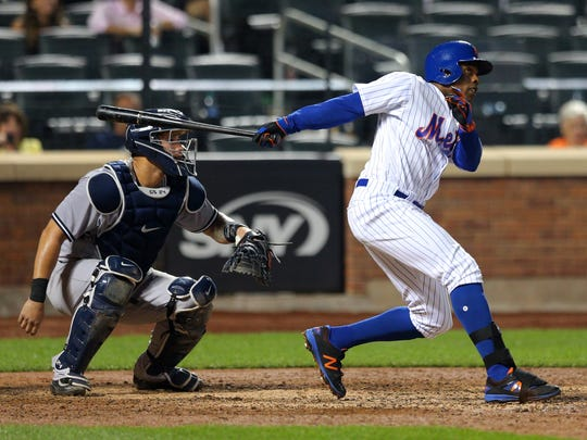 Mets right fielder Curtis Granderson (3) follows through