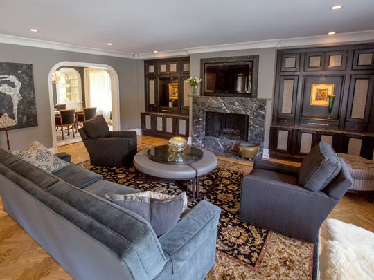 The formal living room is part of the original house, completely redone with black and white to emphasize the architecture. The wall of cabinets  is inset with metal screens.