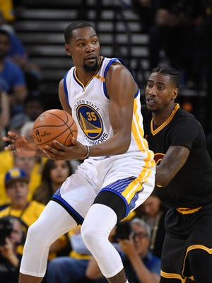 Kevin Durant is defended by Iman Shumpert during the first half in Game 2 of the 2017 NBA Finals.