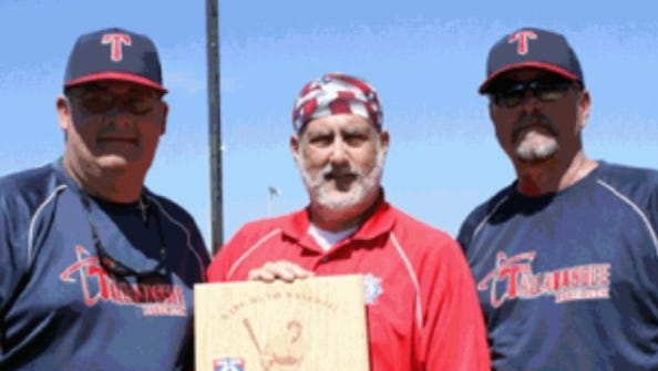 Mike Harrison, left, and Jim Hage receive 15U state