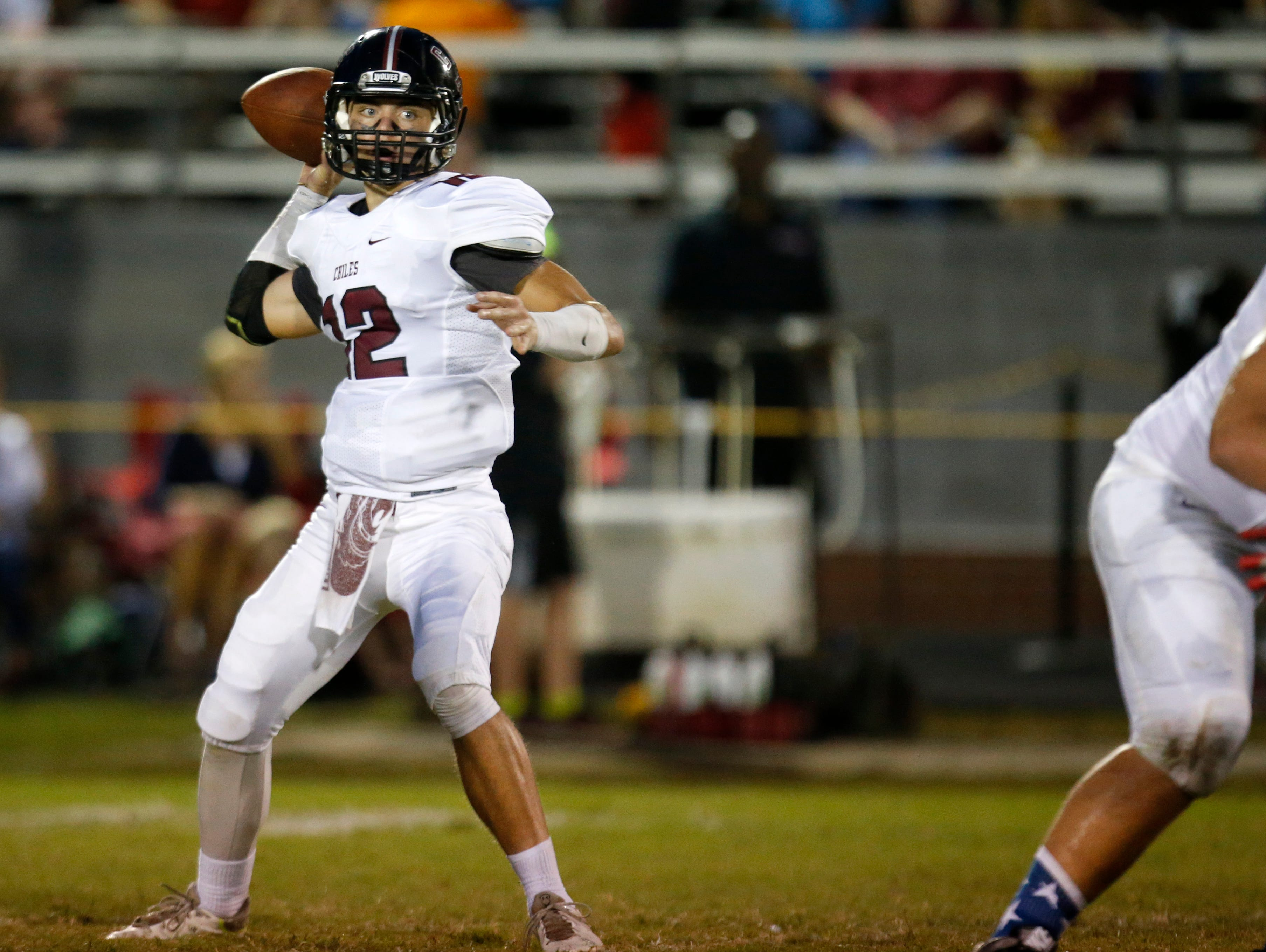 Chiles' quarterback Landon Simpkins throws a pass against NFC during their game at NFC High School on Friday.