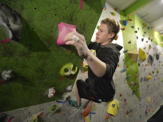Christian Buhler, age 13, a member of the Hi-Line Climbing Team, works out at Hi-Line Climbing Center on Thursday evening.