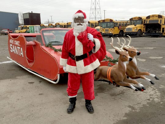 Myron Benford, 71, of Detroit in front of the sleigh he made and drives on Christmas Eve in Detroit and some suburbs. Benford says he's been doing this for four decades.