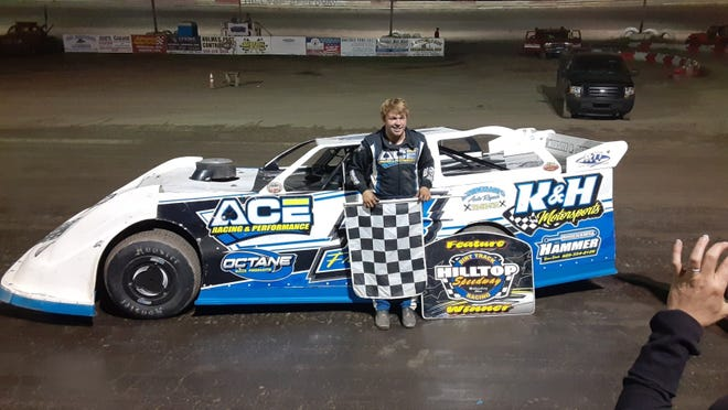 Holmes Tire Late Model feature winner Brandon Francis poses for a photo after the race. It was his first feature win of the year.