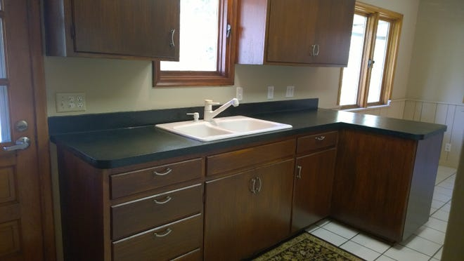 A room gets a different look after counter top is resurfaced.