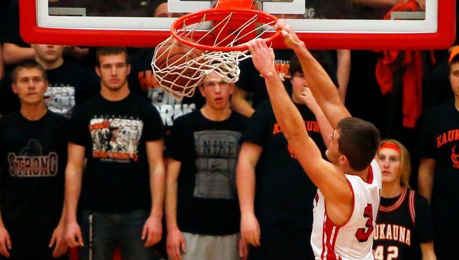 Jordan Janssen of Kimberly dunks the basketball during a Fox Valley Association boys' basketball game against Kaukauna on Jan. 16 at Kimberly High School.