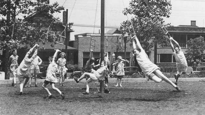 Girls seem to be having the time of their lives as they take a spin on the Maypole swing at the Willard Park playground in 1929. The park, located at 1901 E. Washington St., was named in 1908 for William Willard, the founder of the Indiana School for the Deaf, formerly located on the property.