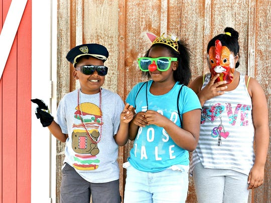 Kids enjoy the photo booth at a previous Summer Bash