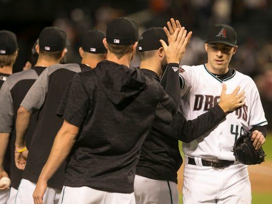 Diamondbacks pitcher Patrick Corbin is congratulated
