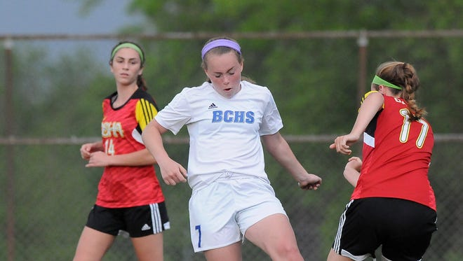 Brookfield Central forward Emma Staszkiewicz (center)  gets tangled up with DSHA midfielder Taylor Massie during a soccer match in May 2016.