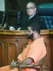 Michael Brandon testifies during the trial of his brother