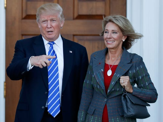 President-elect Donald Trump stands with Education Secretary-designate Betsy DeVos in Bedminster, N.J. on Nov. 19, 2016.
