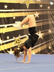 Alaina Ladaro performs gymnastics.