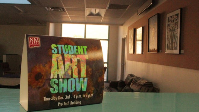 A sign in the Pro Tech building on NMSU-A campus advertises today's NMSU-A student art show. Original student works hang in the background in the lobby of the Pro Tech building.
