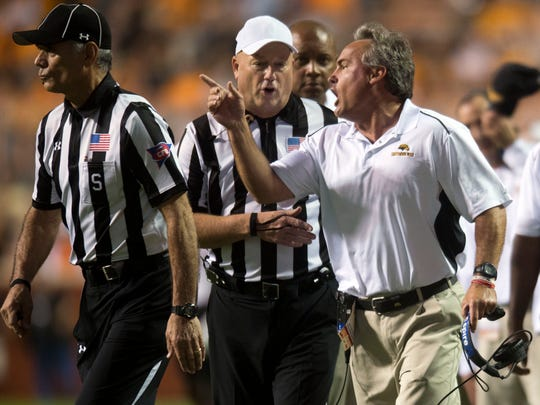 Southern Miss Head Coach Jay Hopson exchanges words with game officials during the game between Tennessee and Southern Miss at Neyland Stadium in Knoxville, Tennessee, on Saturday, Nov. 4, 2017.