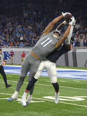 Lions Marvin Jones Jr. stretches out and steals away a possible interception by Bears' Eddie Jackson for a long first down reception in the second quarter.