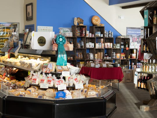 Holland's Family Cheese in Thorp has a retail store offering a variety of cheeses for customers.