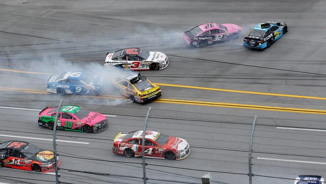 Kevin Harvick's slowing car (4) caused a number of cars, including Matt Kenseth (20) to wreck behind him during the final restart at Talladega.