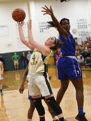 Pascack Valley #4 Brianna Smith  drives to the basket High school girls basketball game between Pascack Valley and Teaneck. Pascack Valley coach Jeff Jasper is 10 wins away from his 1,000th career win