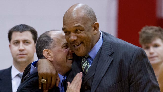 UNA coach Bobby Champagne and Tuskegee University's Leon Douglas meet after the NCAA Division II South Regional Tournament second round game on the campus of Florida Southern College in Lakeland, Florida, Sunday night. UNA lost 93-87.