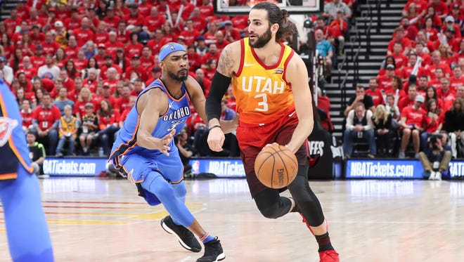 Utah Jazz guard Ricky Rubio (3) dribbles past Oklahoma City Thunder forward Corey Brewer (3) during the fourth quarter in game three of the first round of the 2018 NBA Playoffs at Vivint Smart Home Arena.