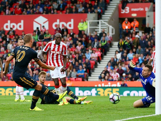 Tottenham Hotspur's Harry Kane, center left, celebrates scoring  against Stoke City during the English Premier League soccer match at The Bet365 Stadium, Stoke-on-Trent, England, Saturday Sept. 10, 2016. (Dave Thompson/PA via AP)