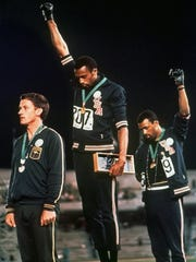 In this 1968 file photo, U.S. athletes Tommie Smith,