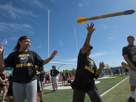Leondre Garibay, right, throws a turbo javelin, with