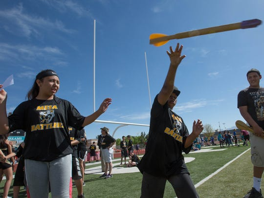Leondre Garibay, right, throws a turbo javelin, with guidance from Desiree Santome, left, both from Mesa Middle School, at an inclusive track meet at the Field of Dreams, Thursday April 5, 2018.