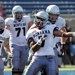 Montana wide receiver Ellis Henderson (7) celebrates with teammates after catching a pass in the end zone against UC Davis during the second half Saturday in Davis, Calif.