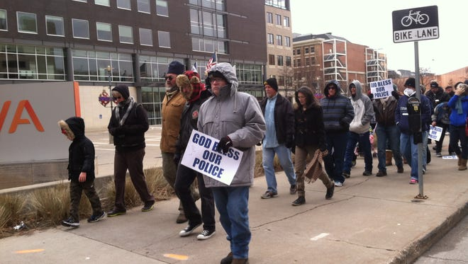 Des Moines residents gather to rally and thank Des Moines Police Officers for their service during a walk Dec. 27, 2014.