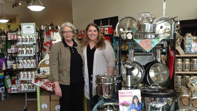 Co-owners Jane Davis-Wood and daughter Sara Woosencraft stand in their specialty kitchen store in Sheboygan.