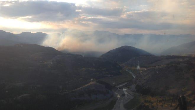 The Sheep Mountain fire burns near the Sun River Friday.