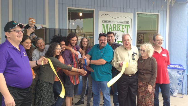 "The Silver City Food Co-op Market Café made the opening of their business official Saturday with a ribbon-cutting celebration in the morning.  The co-op aims to offer healthy food that's also delicious.  ""We have a lot to offer,"" outreach direct Charmeine Wait said, ""We have good food, creative atmosphere and even local artisans who set up in front of our cafe.""  Steve Darland, a Monticello, New Mexico farmer set up a booth and explained the balsamic vinegar making process to makes organic balsamic vinegar making process to shoppers.  While other local vendors showcased their hand made wares."
