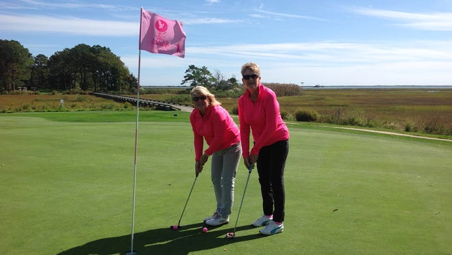Judy Schoellkopf and Nancy Dofflemyer practice their short game in pink at Eagle's Landing golf course in Berlin to prepare for the Pink Ribbon Classic.