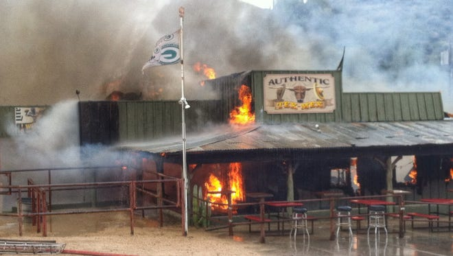 The Buffalo Chip Saloon and Steakhouse, a Cave Creek landmark known for its live bull riding, was in ashes Thursday, Nov. 26, 2015, after a fire tore through the wooden building.