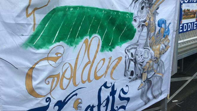 Parents always bring a Golden Knights banner to the team's football games.