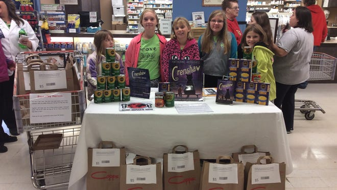 Grove Elementary School fifth-graders held at food drive at Copps to benefit the South Wood Emerging Pantry Shelf.