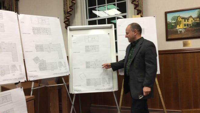 Architect Anthony Iovino of Arcari Iovino presents four possible schemes for bringing the Watchung Library up to code to the Watchung Borough Council and interested citizens.