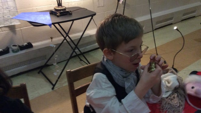 Lex McFarlane enacts his own version of Benjamin Franklin's electricity experiments at the Living Wax Museum at New Jersey Classic Academy Friday evening.