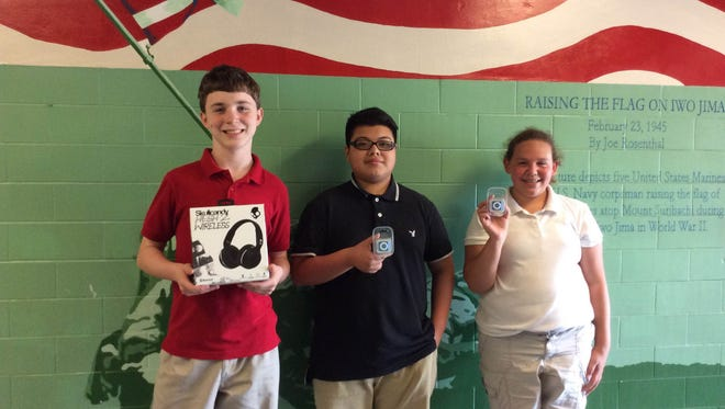 (From left) John Martin, Christian Ruiz and Hallie Bodine, students at Veterans Memorial School in Vineland, won prizes for their ideas to help increase positivity and friendliness at the school.