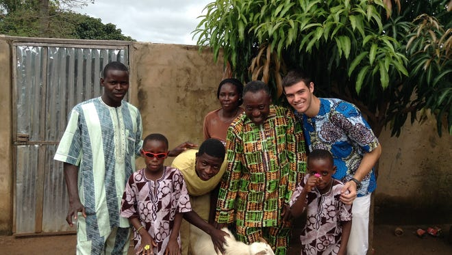 Ben Todd of Murfreesboro poses with one of the families in the village where he lived in Togo, Africa, for two years while serving in the Peace Corps.